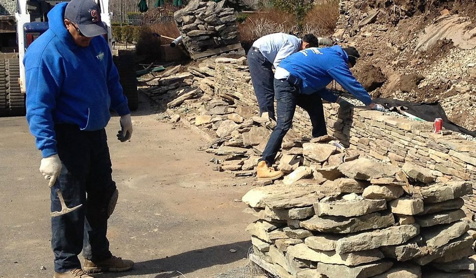 Landscapers Building Stone Wall Design